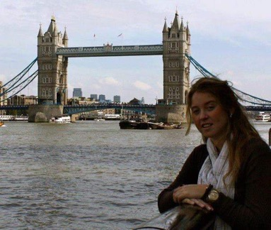 A photo of a student with the London bridge behind them